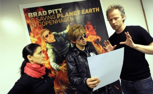 From Day Three of the London Guardian's Copenhagen in Pictures: The director Tue Biering (right) and assistant Marijana Jankovic (left) go through the script with a potential actor wearing a wig and sunglasses during the casting for a film called Brad Pitt is saving Planet Earth in Copenhagen. Every day someone is chosen to act in one scene, culminating in 12 scenes making a movie which will be screened on the internet at the end of the climate conference Photograph: Adrian Dennis/AFP/Getty Images