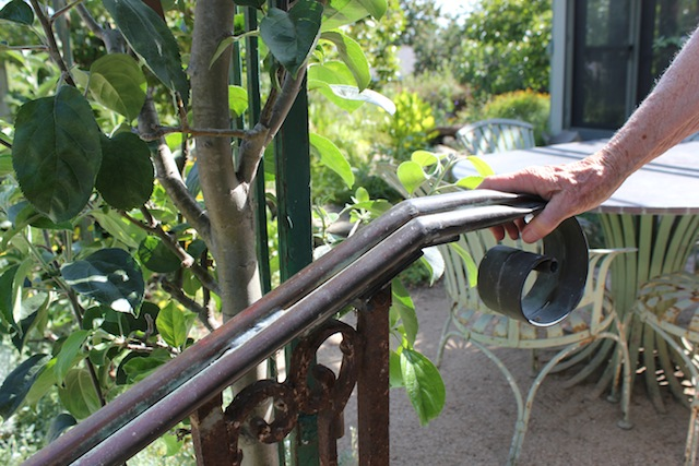 Handrail made of salvaged gutter