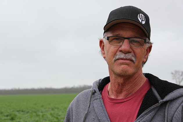 South Delta farmer Rudy Mussi stands in front of his alfalfa field to demonstrate why California's oldest water rights holders should not have to meter long-traditional flood irrigation.