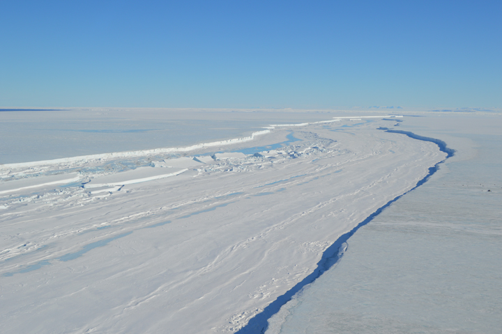 NASA image from December 2015 of a long crack in the Nansen ice-shelf on the Antarctic coast. In early March 2016, with southern winter soon to set in, satellite imagery indicated that the cracking ice front was still attached to the shelf. Even in winter, strong winds can prevent the water beyond the shelf from freezing, so it is unclear whether the front will separate soon or hang on like a loose tooth.